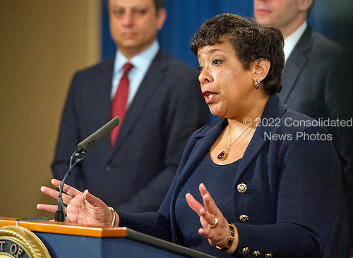 United States Attorney General Loretta E. Lynch answers a reporter's question during a press conference with US Attorney Preet Bharara of the Southern District of New York at the Department of Justice in Washington, DC on Thursday, March 24, 2016.  They announced criminal charges against seven individuals working on behalf of the Iranian government for conducting cyber attacks against the US financial sector and the Bowman Dam in Rye, NY.<br /> Credit: Ron Sachs / CNP<br /> (RESTRICTION: NO New York or New Jersey Newspapers or newspapers within a 75 mile radius of New York City)