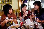 Chinese-Indonesians meet for lunch, in Banda Aceh, Sunday, Nov. 8, 2009.