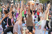 Participants do yoga at the Third Street Promenade during Smartwater's Wanderlust Yoga In The City on Sunday, July 24, 2011.