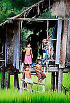 A family on Khong Island in southern Laos preparing for another day on the farm.