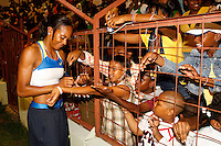 Sanya Richards signing autographs after her 400m win in a time of 50.60sec. at the Jamaica International Invitational Meet on Saturday, May 3rd. 2008. Photo by Errol Anderson, The Sporting Image.