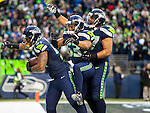 Seattle Seahawks linebackers Bruce Irvin (51), Malcolm Smith (53) and Jordan Hill (97) celebrates Irvin's 49-yard touchdown interception against the St. Louis Rams during the fourth quarter  at CenturyLink Field in Seattle, Washington on December 28, 2014.  The Seahawks officially wrapped up the No. 1 seed in the NFC playoffs shortly after beating the Rams, 20-6. Despite the Cowboys and Packers also winning to finish 12-4, the Seahawks (12-4) won the multi-team tiebreaker and earned home-field advantage throughout the playoffs for the second consecutive season.  ©2014. Jim Bryant Photo. All Rights Reserved.