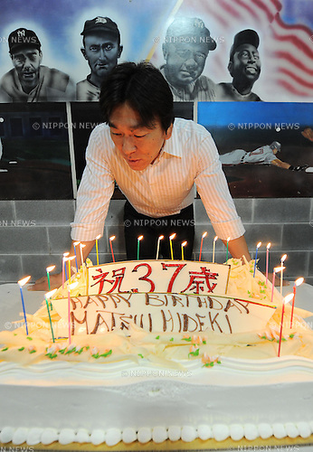 Hideki Matsui (Athletics), JUNE 12th, 2011 - MLB : Hideki Matsui of the Oakland Athletics blows out candles on his 37th birthday cake before the game in Chicago, IL. (Photo by AFLO)