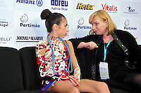 """Rebecca Sereda of USA (junior) talks with her coach at """"kiss & cry"""" after performing in rope Event Final at 2010 World Cup at Portimao, Portugal on March 13, 2010.  (Photo by Tom Theobald)."""
