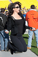 A pretty woman, for some unknown reason, was jumping rope on the sidelines prior to the game. The Pitt Panthers defeated the Louisville Cardinals 20-3 at Heinz Field, Pittsburgh Pennsylvania on October 30, 2010.