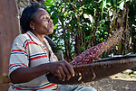 Cebonet Alcide winnows beans in Despagne, an isolated village in southern Haiti where the Lutheran World Federation has been working with residents to improve their quality of life.