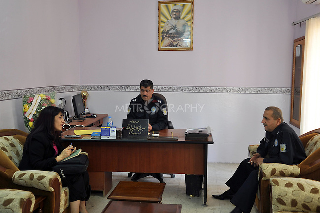 ERBIL, IRAQ: Rezan meets with local police and an official from the Directorate for ERBIL, IRAQ: Following Violence Against Women about a case where a woman committed suicide in Erbil.  The Directorate was opened by the KRG Ministry of Interior after the stoning of Dua.