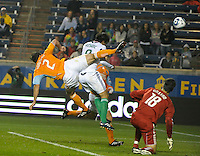Chicago midfielder Baggio Husidic (9) heads in the first Chicago goal despite a leaping effort by Houston defender Eddie Robinson (2).  The Chicago Fire defeated the Houston Dynamo 2-0 at Toyota Park in Bridgeview, IL on April 24, 2010.