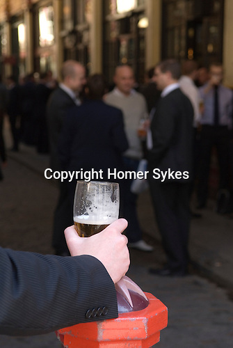 Office workers lunchtime drink City of London UK