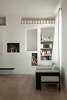 Alcoves in the television room provide useful storage
