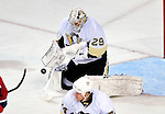 6 February 2010: Pittsburgh Penguins' goaltender Marc-Andre Fleury keeps track of a rebounding puck after making a save in the second period against the Montreal Canadiens at the Bell Centre in Montreal, Quebec, Canada. The Canadiens defeated the Penguins 5-3. Mandatory Credit: Ed Wolfstein Photographer