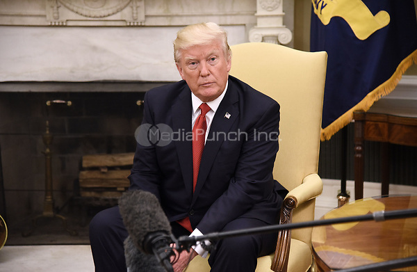 United States President Donald J. Trump looks on during a meeting with President Juan Manuel Santos of Colombia in the Oval Office of  the White House, on May 18, 2017 in Washington, DC. <br /> Credit: Olivier Douliery / Pool via CNP/MediaPunch