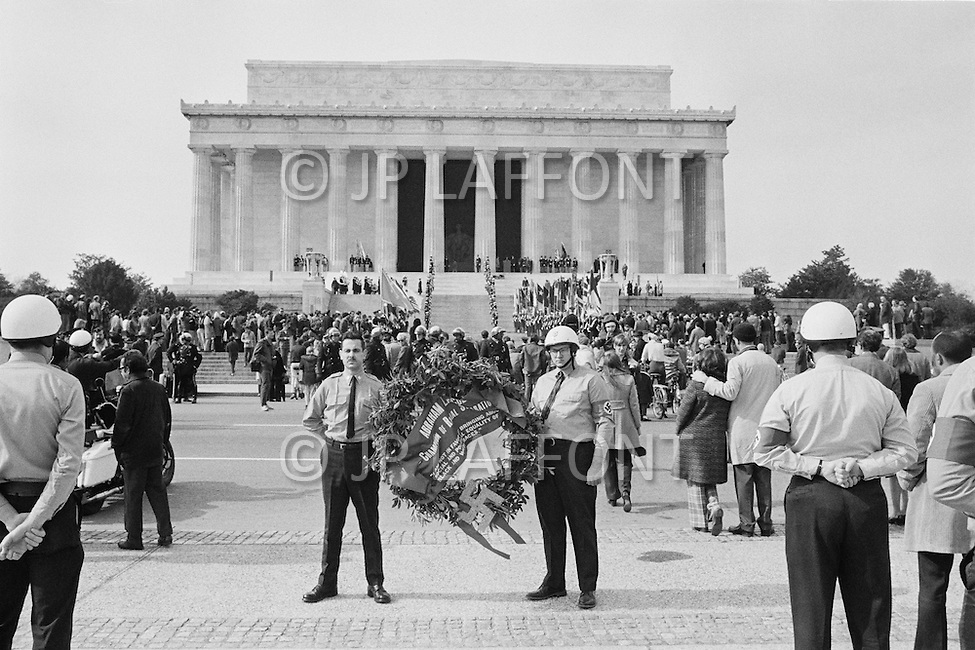 12 Feb 1972, Washington, DC, USA --- On Abraham Lincoln's birthday, the Commander of the National Socialist White People's Party, Matt Koehl, and his troops pay tribute by laying flowers at the Lincoln Memorial. The police are in attendance watching the ceremony. --- Image by © JP Laffont/Sygma/Corbis