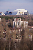 An overview of the Chernobyl nuclear power plant towering in front of Pripyat, a ghost town left deserted by the nuclear disaster in the Chernobyl power station nearby. 30 years on, the city is still heavily contaminated, unfit for human life. <br /> <br /> The Chernobyl nuclear disaster happened on 26 April 1986.