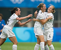 New Zealand's (11) Kirsty Yallop celebrates her goal with teammates (15) Emma Kete and Katie Hoyle during first round play in the 2008 Beijing Olympics at Qinhuangdao, China. .  Japan tied New Zealand, 2-2, at Qinhuangdao Stadium.