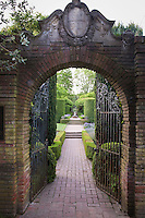 Brick path through entry gate to Filoli wall garden, formal landscape architecture design showing axial view