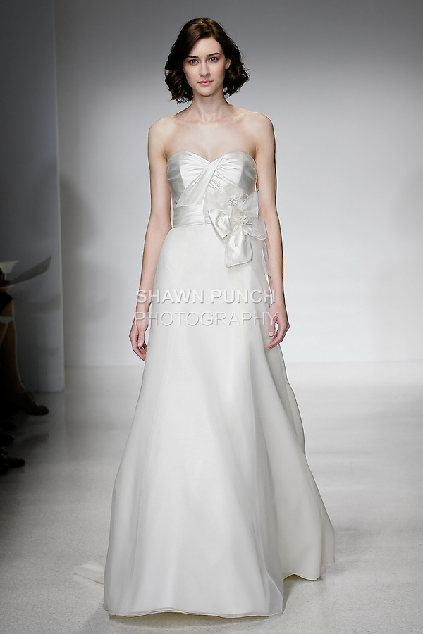 Model walks runway in a Brenna wedding dress by Amsale Aberra, for the Christos Spring 2012 Bridal runway show.
