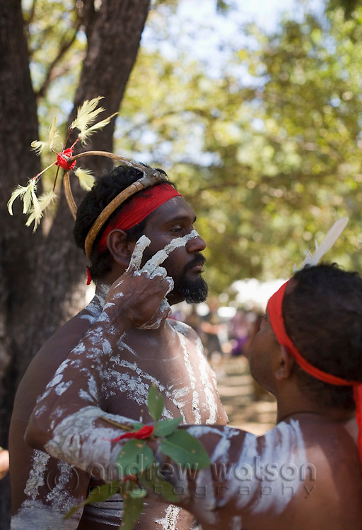 Indigenous dancers applying body paint at the Laura Aboriginal Dance Festival.  Laura, Queensland, Australia