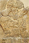 Chaldean Assyrian relief sculpture slab from the northwest palace of King Ashurnasirpal II of a Genie standing. 881-859 B.C form Nimrud or Ni=mrut ( Kalhu or Kalah). Istanbul Archaeological exhibit Inv. No. 6.