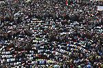 Opponents of Egypt's President Mohammed Mursi gather for noon prayers at Tahrir Square, the focal point of Egyptian uprising, in Cairo June 30, 2013.  Mass demonstrations across Egypt on Sunday may determine its future, two and half years after people power toppled a dictator they called Pharaoh and ushered in a democracy crippled by bitter divisions. Photo by Ahmed Asad