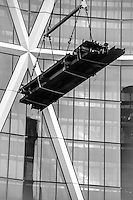 Abstract photograph of a crane lifting Iron onto the Bow Tower in Calgary Alberta, Canada.