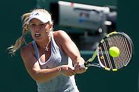 Caroline WOZNIACKI (DEN) against Justine HENIN (BEL) in the Quarter Finals of the women's singles. Justine Henin beat Caroline Wozniacki 6-7 6-3 6-4..International Tennis - 2010 ATP World Tour - Sony Ericsson Open - Crandon Park Tennis Center - Key Biscayne - Miami - Florida - USA - Wed 31st Mar 2010..© Frey - Amn Images, Level 1, Barry House, 20-22 Worple Road, London, SW19 4DH, UK .Tel - +44 20 8947 0100.Fax -+44 20 8947 0117