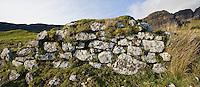 Crumbling stone wall of old croft building, Trotternish, Isle of Skye, Scotland