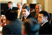 United States President Ronald Reagan, left, listens to the discussion with Soviet experts over lunch at the White House on Thursday, November 7, 1985.  U.S. Secretary of State George Shultz, center, and U.S. Secretary of Defense Caspar Weinberger, right, listen as well..Mandatory Credit: Pete Souza - White House via CNP