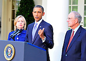 United States President Barack Obama makes a statement in the Rose Garden of the White House following his bi-lateral meetings with Middle Eastern leaders in Washington, D.C. on Wednesday, September 1, 2010.  His statement is in advance of the opening of the first direct talks in two years between Israel and the Palestinian Authority scheduled to begin at the State Department in Washington, D.C. tomorrow.  U.S. Secretary of State Hillary Rodham Clinton looks on from left and Special Envoy to the Middle East George Mitchell is at right..Credit: Ron Sachs / Pool via CNP