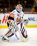 26 October 2009: New York Islanders' goaltender Dwayne Roloson warms up prior to a game against the Montreal Canadiens at the Bell Centre in Montreal, Quebec, Canada. The Canadiens defeated the Islanders 3-2 in sudden death overtime for their 4th consecutive win. Mandatory Credit: Ed Wolfstein Photo