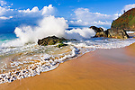 Crashing waves and rocks at Hanakapi'ai Beach, Na Pali Coast, Island of Kauai, Hawaii USA