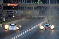 Jul, 20, 2012; Morrison, CO, USA: NHRA funny car driver Jack Beckman (left) races alongside Cruz Pedregon during qualifying for the Mile High Nationals at Bandimere Speedway. Mandatory Credit: Mark J. Rebilas-US PRESSWIRE