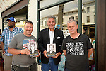 Huntington, New York, U.S. - August 6, 2014 - L - R front, GREG PACKER, of Huntington, CHARLIE PACIULLO, of Coram, and KENNY MITCHELL, of Garden City, are the first three people on line to attend the book signing for H. Clinton's new memoir, Hard Choices, at the Book Revue in Huntington, Long Island. Packer had been waiting since 4 am, Paciullo since 1 am that day, and Mitchell had been waiting since 11:10 pm the night before.
