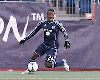 Sporting Kansas City defender Mechack Jerome (24) looks to cross.  In a Major League Soccer (MLS) match, Sporting Kansas City (blue) tied the New England Revolution (white), 0-0, at Gillette Stadium on March 23, 2013.