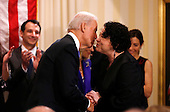 United States Vice President Joe Biden (L) kisses U.S. Supreme Court Justice Sonia Sotomayor after taking the oath of office at the U.S. Naval Observatory in Washington January 20, 2013.     .Credit: Kevin Lamarque / Pool via CNP