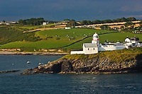 A view from a cruise ship of the Irish coast with a lighthouse.