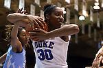 24 January 2016: Duke's Amber Henson (30) grabs a rebound away from North Carolina's N'Dea Bryant (22). The Duke University Blue Devils hosted the University of North Carolina Tar Heels at Cameron Indoor Stadium in Durham, North Carolina in a 2015-16 NCAA Division I Women's Basketball game. Duke won the game 71-55.
