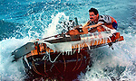 8/1994-Al Diaz/Miami Herald--In 1994 Cuban balseros turned the tiny fishing village of Cojimar into a major point of embarkation for thousands seeking a better life. Here, a Cuban rafter tries to control his makeshift vessel as he prepares to leave the coast of Cuba at Cojimar.
