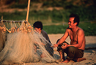 Fisherman tends to net on beach, Ban Pak Ou, Luang Phrabang, Laos