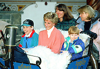Diana, The Princess of Wales, Prince William and Prince Harry, ride in a horse drawn sleigh, in Lech Austria, during their annual ski holiday, accompanied by the Princess's friends Catherine Soames, and Kate Menzies.