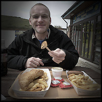 Mark eating fish and chips at Lulworth Cove