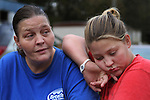 Nicole Hensley, age 15, leans on her mother's shoulder on Thursday, Oct. 13, 2011. They were visiting with friends and family in front of  their home in Breathitt County, Ky. Photo by Latara Appleby