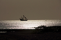 Grand Cayman. A sailing ship at sunset.