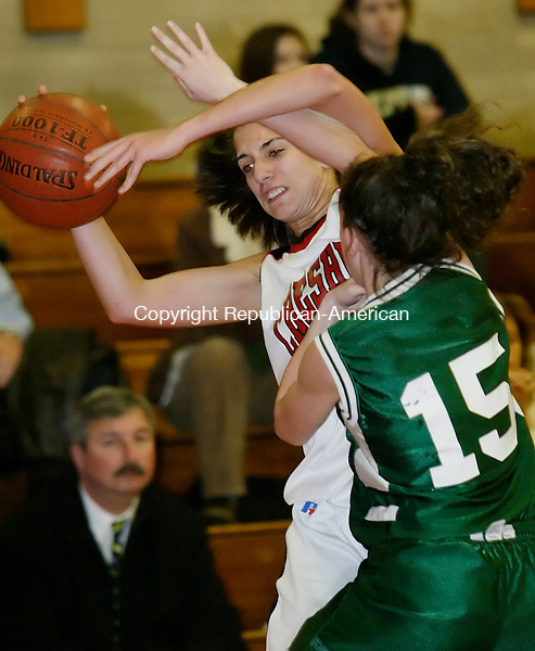 CHESHIRE, CT 29 December 2005 -122905BZ06-   Cheshire #10, Taryn Belowsky gets pressured by Guilford #15, Alex Hoey <br /> during their game at Cheshire High Thursday night.<br /> Jamison C. Bazinet Republican-American