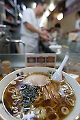 "A soy sauce based ramen inside the very established, very highly regarded and traditional ( or ""old school"") 'Harukiya' ramen noodle restaurant in Ogikubo district of Tokyo, Japan, Friday 30th April 2010."