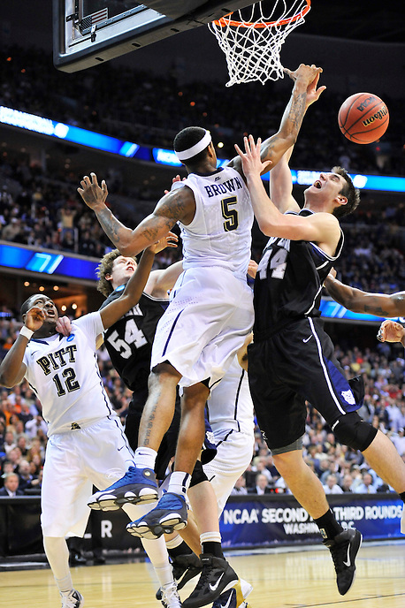 Andrew Smith of the Bulldogs if fouled while going to the basket. Butler upset no.1 seed Pittsburgh 71-70 during the 3rd round of the NCAA Tournament at the Verizon Center in Washington, D.C on Saturday, March 19, 2011. Alan P. Santos/DC Sports Box