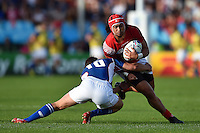 Latiume Fosita of Tonga is tackled by Theuns Kotze of Namibia. Rugby World Cup Pool C match between Tonga and Namibia on September 29, 2015 at Sandy Park in Exeter, England. Photo by: Patrick Khachfe / Onside Images