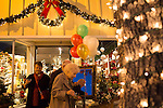 Downtown shop owners welcomed guests into their stores with colorful lights and decorations for the annual Holiday Stroll.