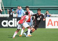 DC United midfielder Chris Pontius (13) goes against AFC Ajax defender Vurnon Anita (5)     AFC Ajax defeated DC United 2-1 during an International Friendly at RFK Stadium Sunday May 22, 2011.