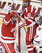 Joe Pereira (BU - 6) and Corey Trivino (BU - 10) celebrate Pereira's goal. - The Boston College Eagles defeated the visiting Boston University Terriers 5-2 on Saturday, December 4, 2010, at Conte Forum in Chestnut Hill, Massachusetts.